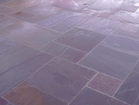 Celtic bronze sandstone patio in the standard 4 size mixed random design.
