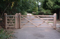 Oak entrance gate with pedestrian access point.